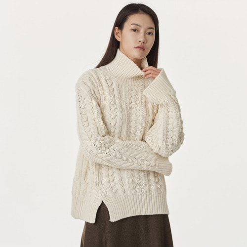C. circle cable turtle knit